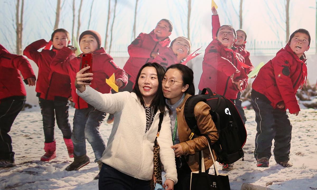 Visitors explore <em>The Field of Hope</em> exhibition.  Photo: Courtesy of China Photographers Association