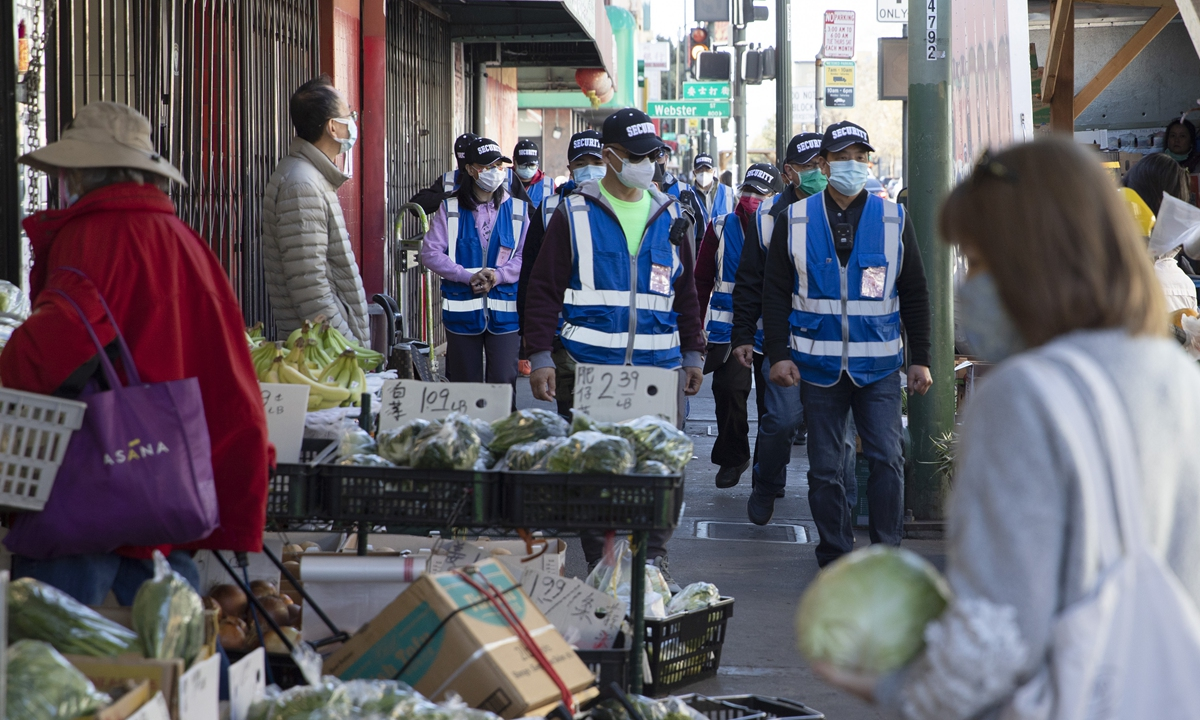 A  volunteer security team voluntarily formed by local Chinatown businesses and residents patrols Chinatown, in Oakland, California, the US, on March 6. Photo: VCG