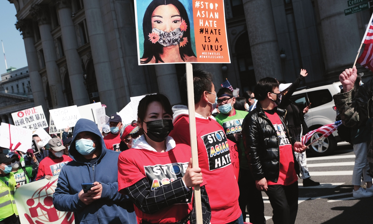 People participate in a protest to demand an end to anti-Asian violence on April 4 in New York City, the US. Photo: VCG
