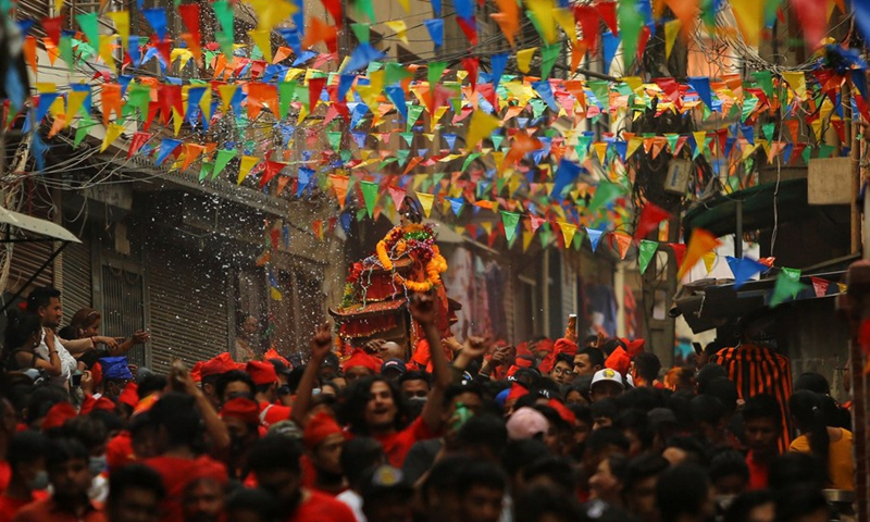 Nepalese devotees of the Newar community, an ancient community of Kathmandu, parade to celebrate the Pahchare Chariot Festival, locally known as a 'Daya Lyagu' at Aason in Kathmandu, Nepal, April 12, 2021.(Photo: Xinhua)