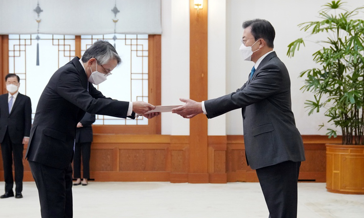 South Korean President Moon Jae-in (right) receives the credentials of Japanese Ambassador to Seoul Koichi Aiboshi at the presidential office in Seoul on Wednesday. Moon told the Japanese envoy that South Korea was deeply concerned about Japan's decision to dump Fukushima wastewater into the sea and requested the ambassador to convey his position to the Japanese government. Photo: cnsphoto