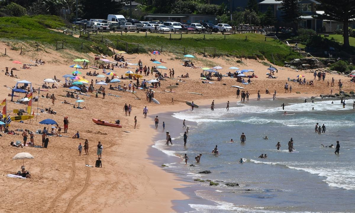 People enjoy the afternoon sunshine at Avalon Beach on January 10 in Sydney, Australia. Photo: VCG
