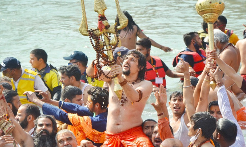 People taking holy dip at river Ganga during Kumbh festival in Haridwar, India on April 14, 2021.(Photo: Xinhua)