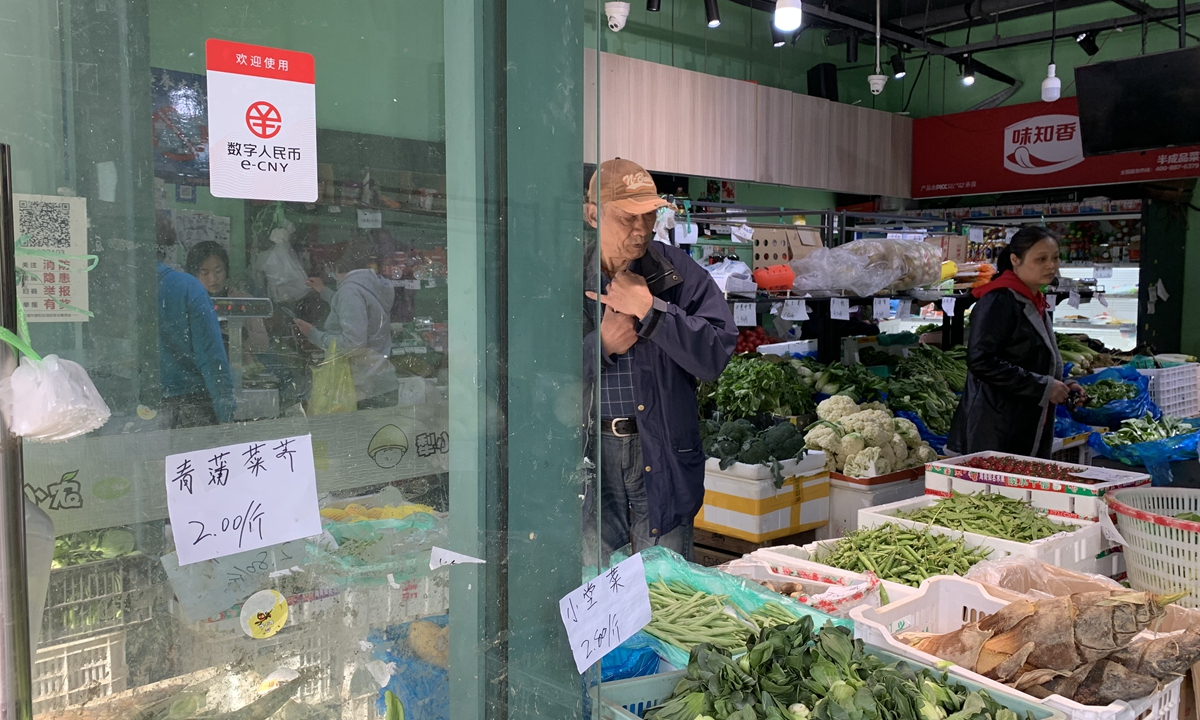 A vegetable store supports digital yuan payment in Shanghai. Photo: Qi Xijia/GT