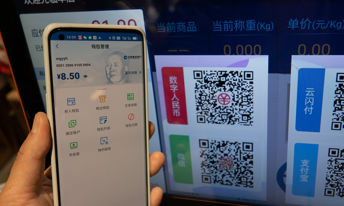 On Tuesday, Shanghai residents used digital yuan to buy fruit at a market. China has held large-scale tests of its digital currency since October, with trials in cities including Beijing, Shanghai, Shenzhen, Suzhou and Chengdu. Photo: cnsphoto