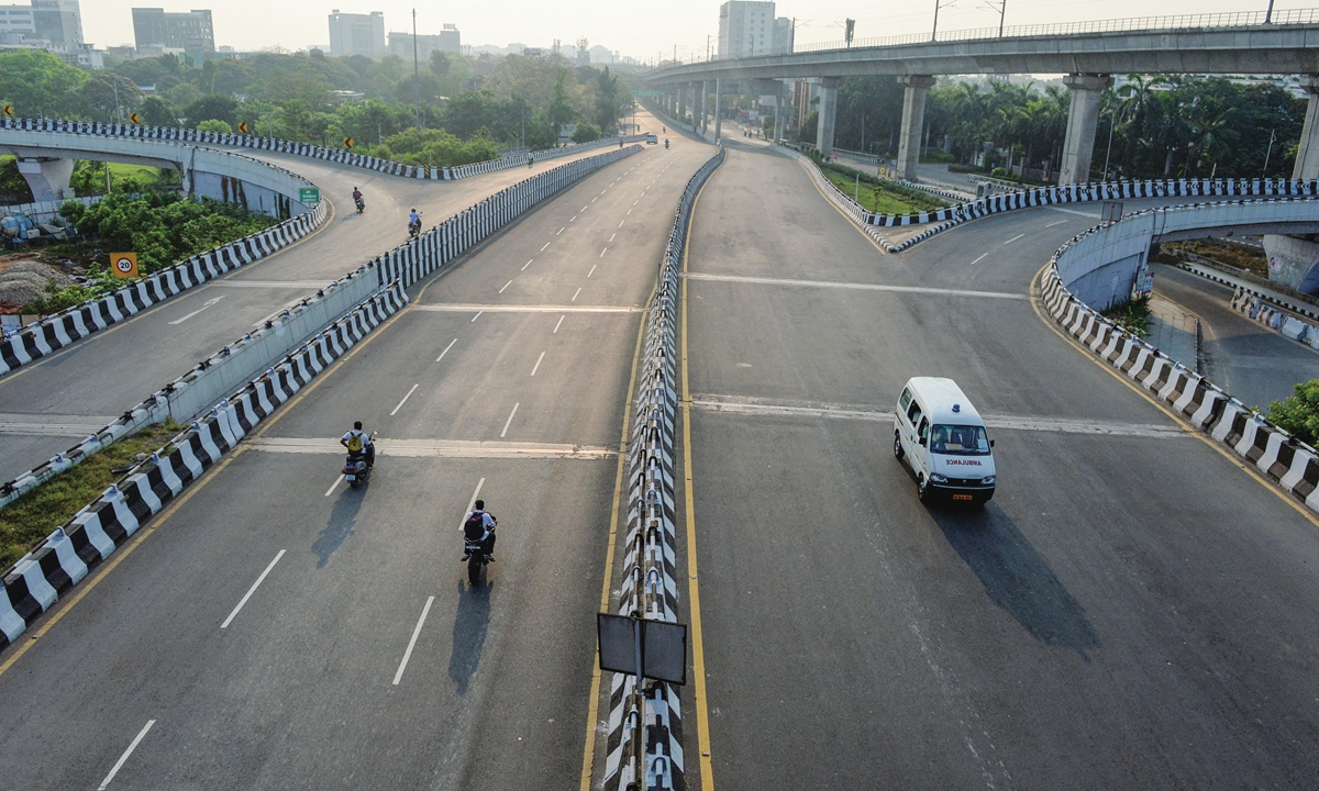 A partially deserted road is seen during the Sunday lockdown imposed as a preventive measure against the spread of the COVID-19 in Chennai, India, on Sunday. Photo: AFP