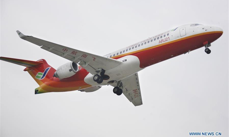 The third ARJ 21-700 jet flies in Shanghai, east China, on Sept. 12, 2009. Subsidiaries of Aviation Industry Corporation of China (AVIC) and Commercial Aircraft Corporation of China Ltd. (COMAC) have set up a joint design center to develop noses for China-developed commercial aircraft, AVIC said Nov. 21, 2018.(Photo: Xinhua)