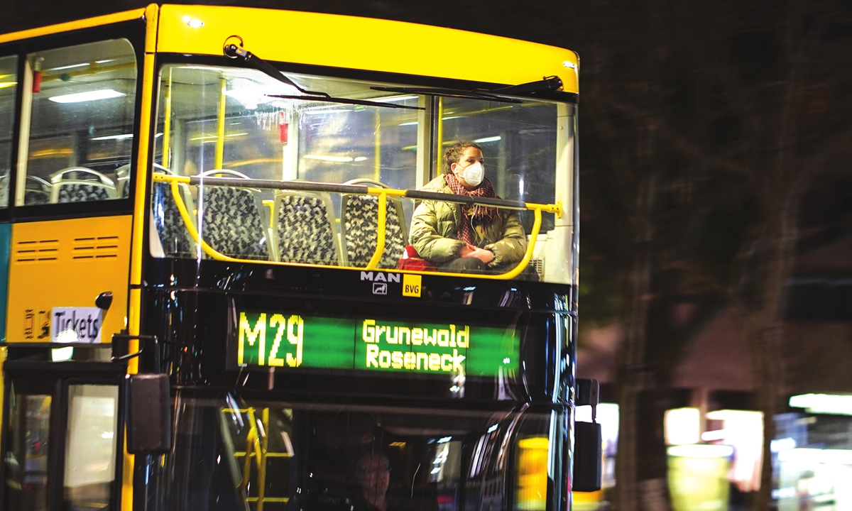 A woman wearing a mask rides a bus in Berlin, Germany, on Saturday, the day new emergency brake rules kicked off in the country. The measures, including a nighttime curfew and strict limits on social contacts, come into force if cities or districts exceed a seven-day incidence rate of 100 new infections per 100,000 inhabitants over three consecutive days. Photo: Xinhua