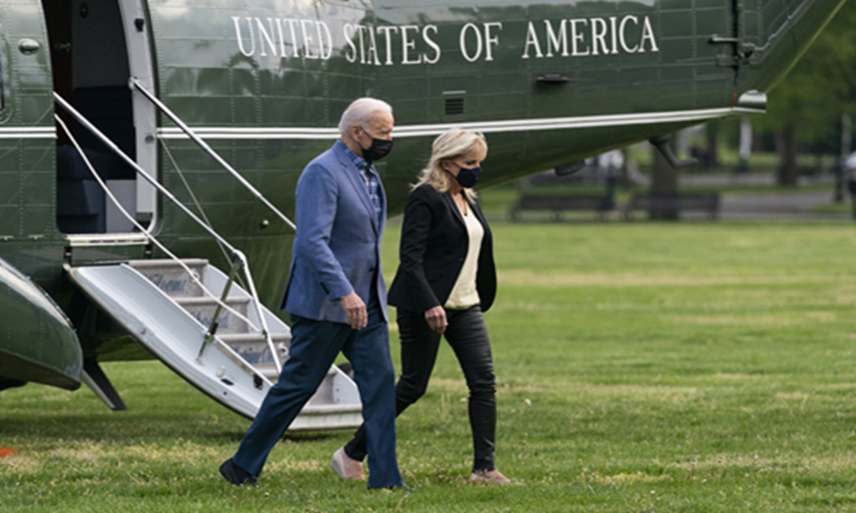 President Joe Biden walks from Marine One with first lady Jill Biden on the Ellipse near the White House after spending the weekend in Wilmington, Del., on Sunday in Washington. Photo: VCG