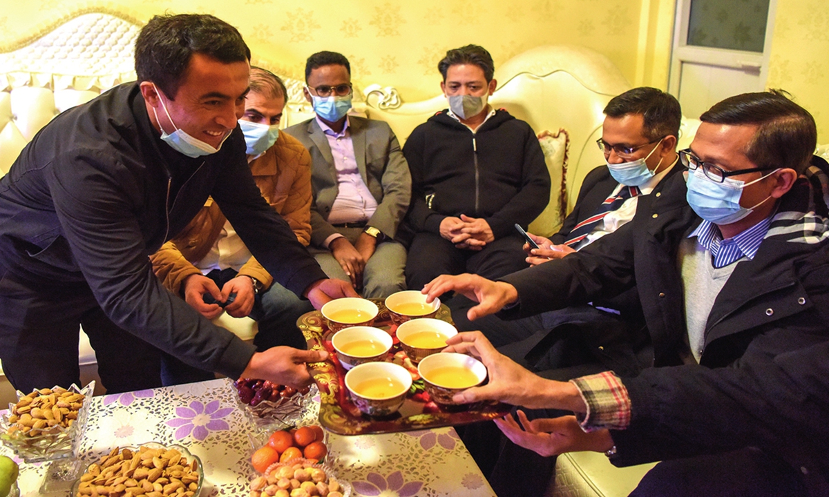 Foreign diplomats delegation comprising Vladimir Norov, secretary-general of the Shanghai Cooperation Organization (SCO), and more than 30 diplomats from 21 countries visit a resident in Nazarbagh town of Kashi in Xinjiang on March 31, 2021. Photo: Xinhua