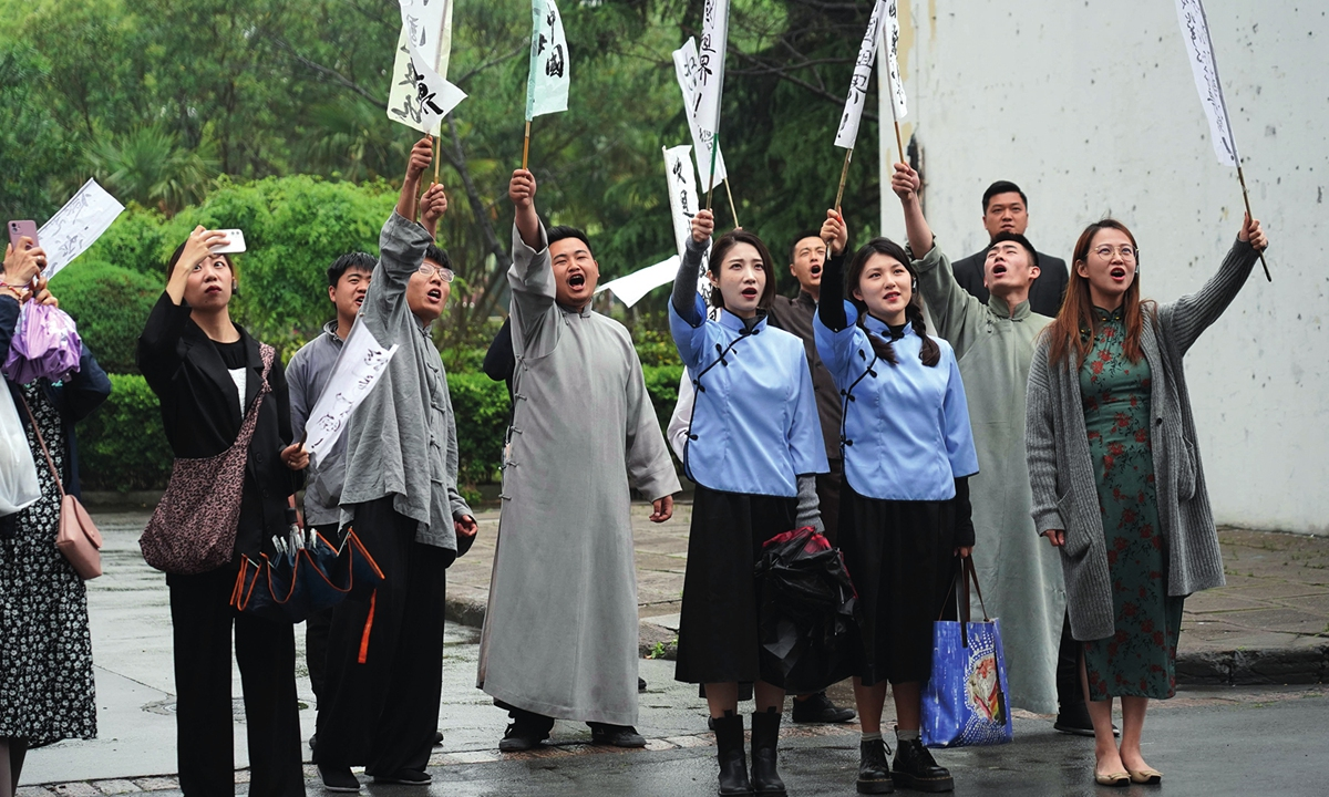 Visitors play in a patriotic anti-imperialist drama to better learn the history of the CPC during their visit to Shanghai Film Park on Tuesday. Photo: Xinhua