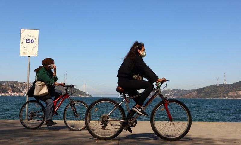 People ride bikes near the Bosporus Straits in Istanbul, Turkey, April 26, 2021.Photo:Xinhua