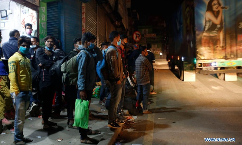 People wait for the long route bus to go back to their village prior to lockdown imposed to curb the COVID-19 infections in Kathmandu, Nepal, April 28, 2021.Photo:Xinhua