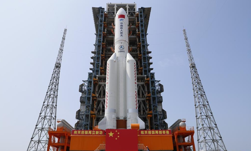 Photo taken on April 23, 2021 shows the combination of the core module of China's space station, Tianhe, and the Long March-5B Y2 rocket after it was transported to the launching area of the Wenchang Spacecraft Launch Site in south China's Hainan Province.Photo:Xinhua