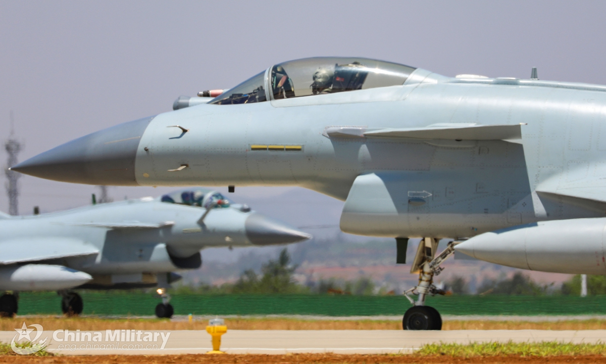 Fighter jets attached to an aviation brigade of the air force under the PLA Southern Theater Command get ready to take off from the runway for a flight training exercise in late April, 2021.Photo:China Military