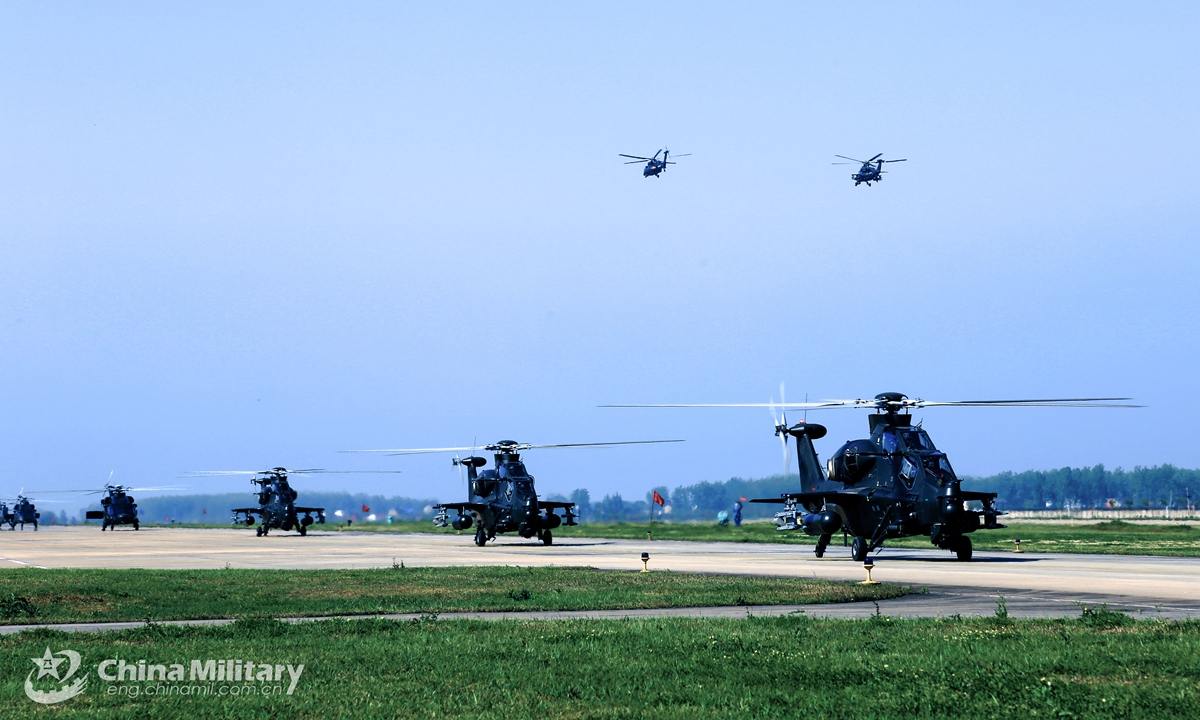 Attack helicopters attached to a naval aviation brigade under the PLA Eastern Theater Command sit in formation on the parking apron during a flight training exercise in April 19,2021. Photo:China Military