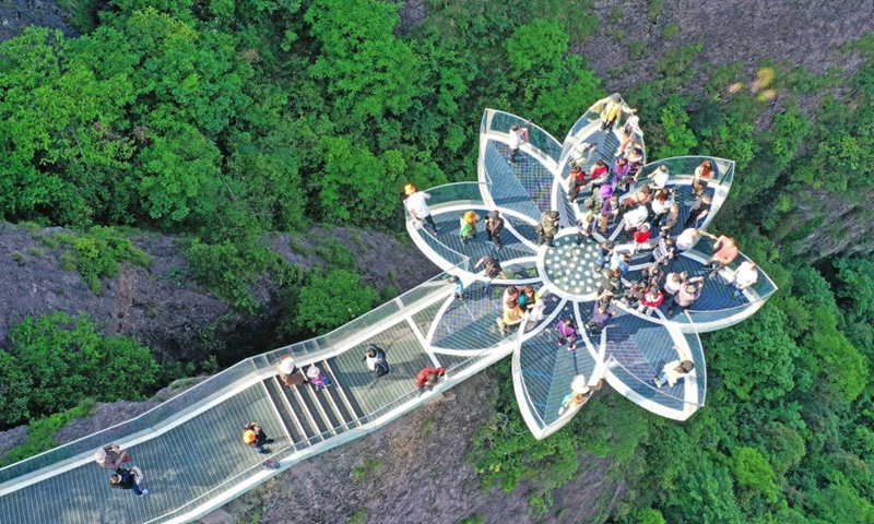 Aerial photo taken on May 2, 2021 shows visitors at Shenxianju scenic area in Taizhou, east China's Zhejiang Province. Sunday marks the second day of China's five-day May Day holiday. (Photo by Wang Huabin/Xinhua)