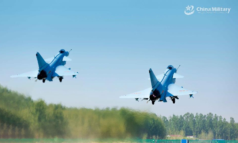 Fighter jets attached to an aviation brigade of the air force under the PLA Central Theater Command take off for cross-area maneuver training in April 19, 2021. The exercise involved training items including cross-area maneuver, long-distance flight after midnight and take-off and landing in unfamiliar airport. (eng.chinamil.com.cn/Photo by Wang Chenyang)
