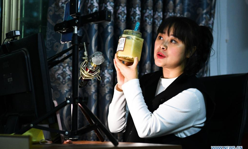 Yuan Xiaomei promotes her honey products through livestreaming in Nayong County, southwest China's Guizhou Province, April 28, 2021.(Photo: Xinhua)