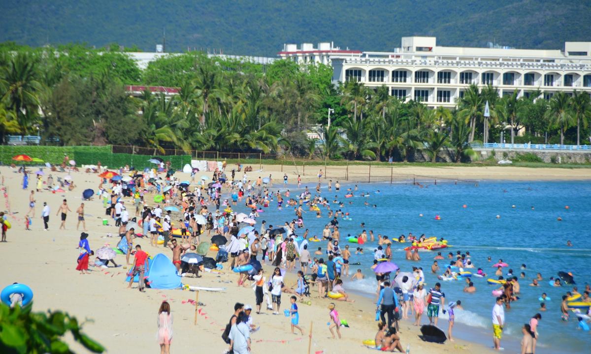 People enjoy the tropical beach of Sanya, South China's Hainan Province during the May Day holidays. Photos: IC