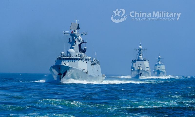 Warships attached to a destroyer flotilla with the navy under the PLA Eastern Theater Command steam in astern formation in waters of the East China Sea during the realistic training on April 23, 2021.  Photo: China Military Online