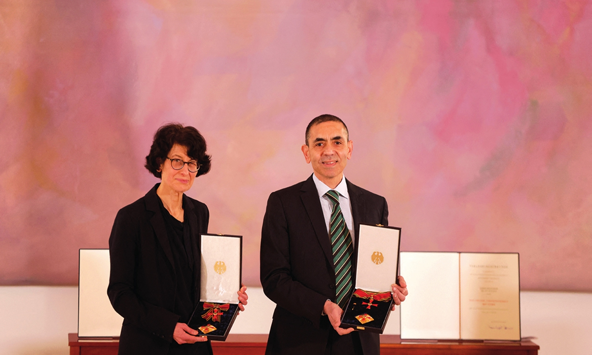 The couple, Ozlem Tureci (left) and Ugur Sahin, both scientists and founders of BioNTech, pose after they were awarded the Federal Cross of Merit by the German President on March 19 in Berlin. Photos: AFP