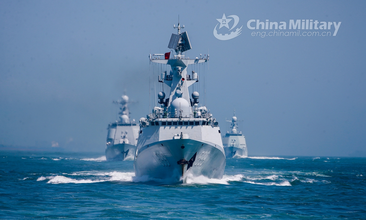 Warships attached to a destroyer flotilla with the navy under the PLA Eastern Theater Command steam in astern formation in waters of the East China Sea during the realistic training on April 23, 2021.Photo:China Military