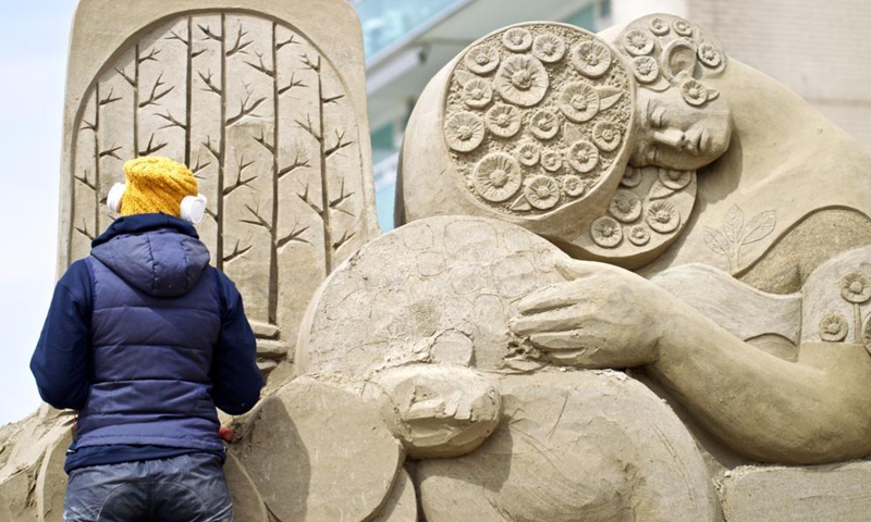 An artist works on a sand sculpture during the European Sand Sculpture Championships in Zandvoort, the Netherlands, May 6, 2021. The European Sand Sculpture Championship is staged in Zandvoort for the tenth time. Photo:Xinhua