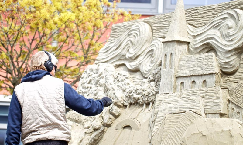 An artist works on a sand sculpture during the European Sand Sculpture Championships in Zandvoort, the Netherlands, May 6, 2021. The European Sand Sculpture Championship is staged in Zandvoort for the tenth time.Photo:Xinhua