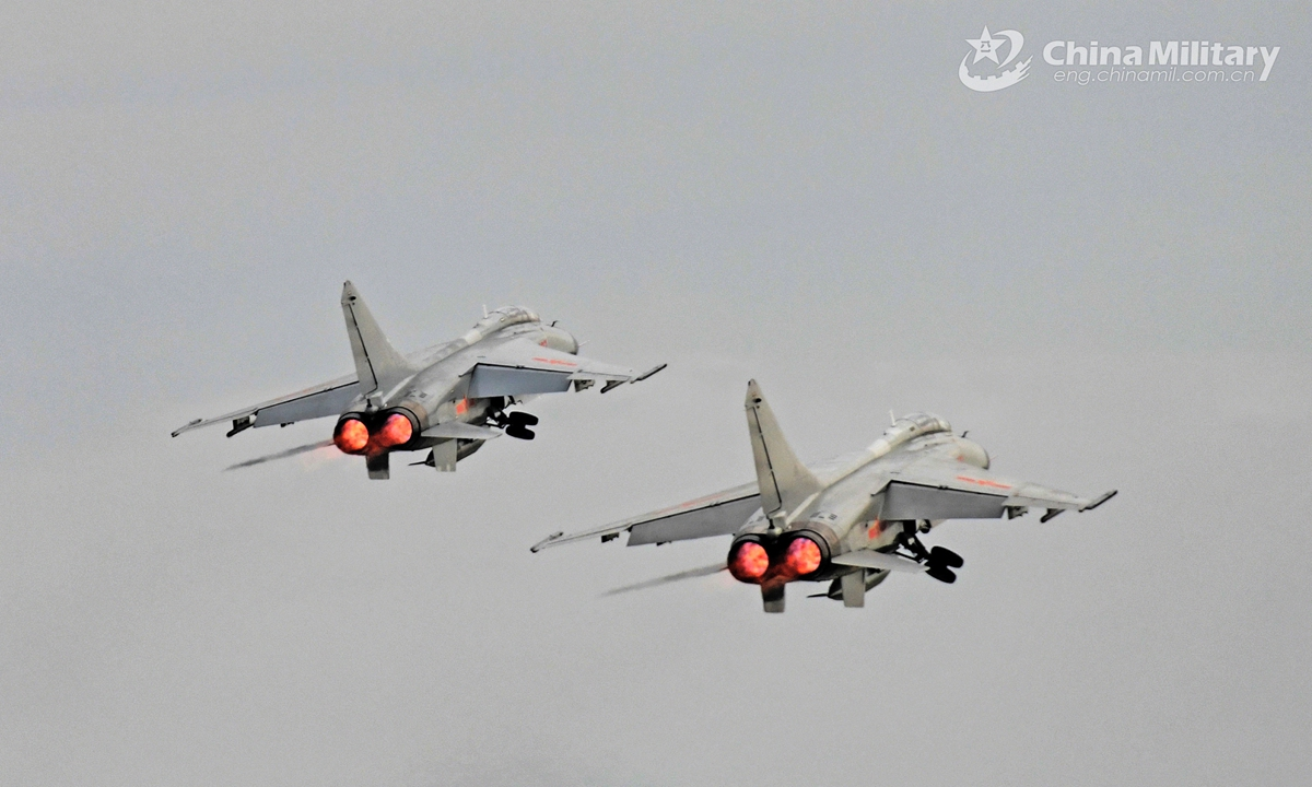 Fighter jets attached to an aviation brigade with the navy under the PLA Southern Theater Command take off for a round-the-clock training exercise on April 20, 2021. Photo: China Military Online