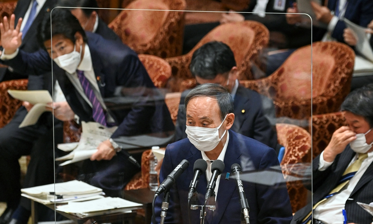 Japan's Prime Minister Yoshihide Suga (C) answers a question during a lower house budget committee session at parliament in Tokyo on May 11, 2021. Photo: VCG