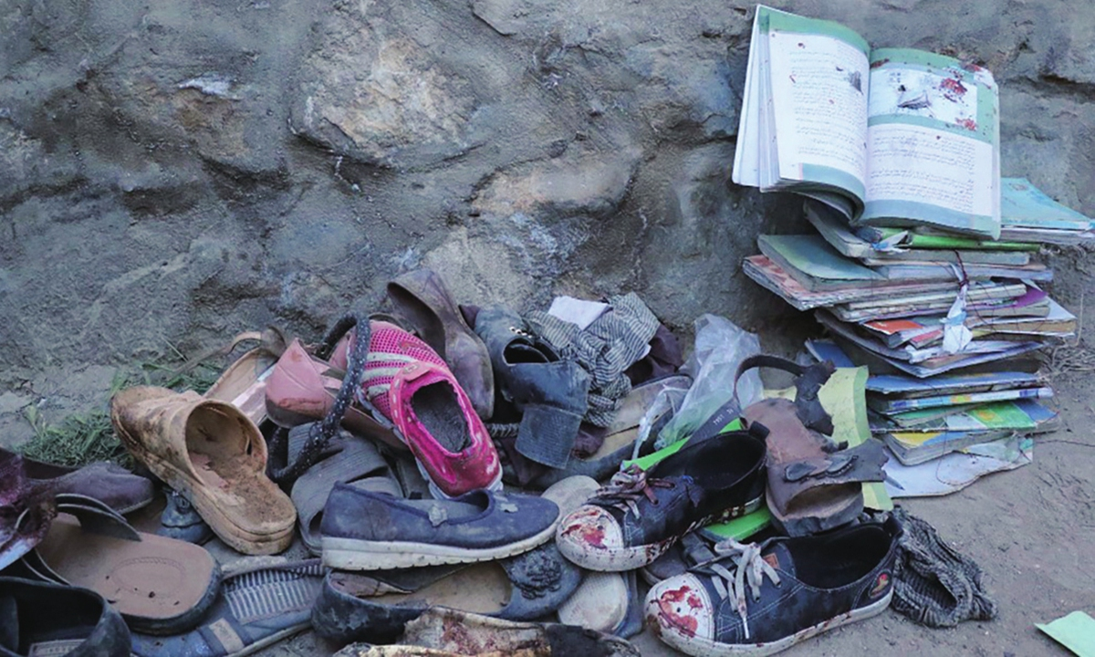 A view from the site, where mostly schoolgirls, have been killed in three back-to-back blasts targeting a school in Afghanistan's capital Kabul on Saturday Photo: AFP
