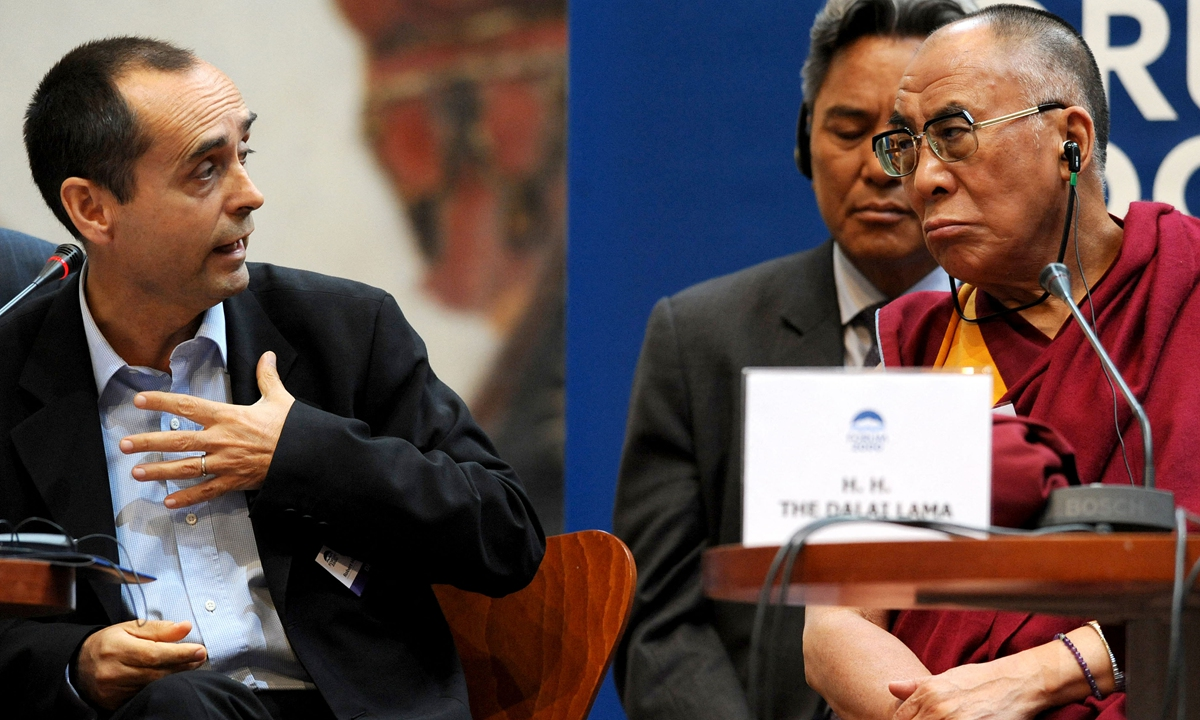The Dalai Lama (right) reacts to a speech by Robert Menard, former secretary-general of Reporters Without Borders. Reporters Without Borders has been colluding with separatists against China. Photo: AFP