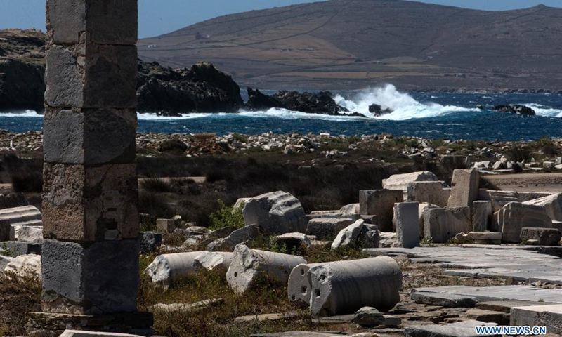 Part of the archaeological site of the island Delos is seen in Delos, Greece, on May 10, 2021. Delos, once a booming trading center in the middle of the Aegean Sea near Mykonos, is a UNESCO world heritage with a history of 5,000 years. It is one of the most important mythological, historical and archaeological sites in Greece.(Photo: Xinhua)