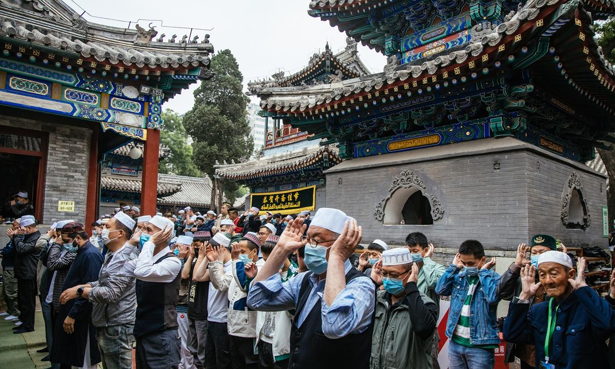 Muslims gather at Niujie Mosque, Beijing to celebrate Eid al-Adha. Photo: Li Hao/GT
