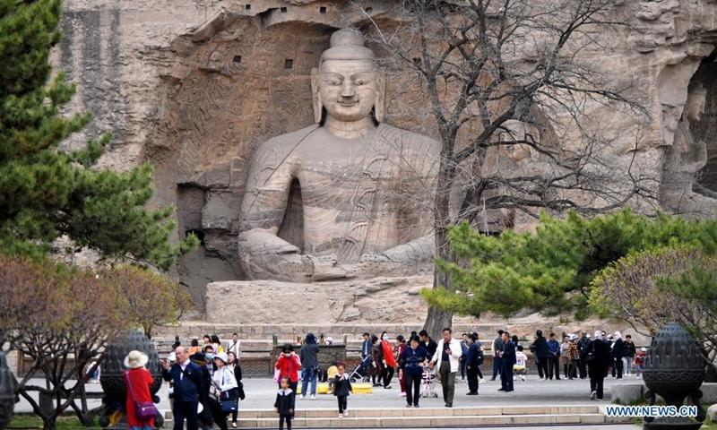 Tourists visit the Yungang Grottoes in Datong, north China's Shanxi Province, on May 9, 2021.Photo:Xinhua