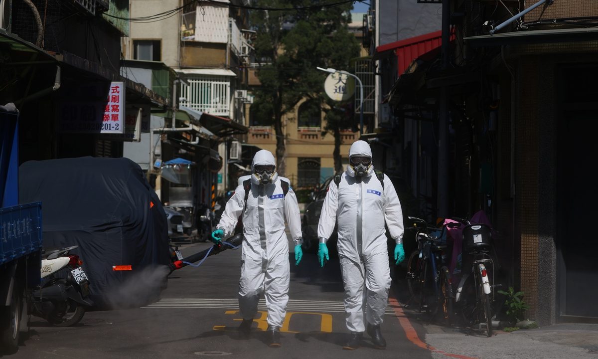 Workers disinfect Wanhua district, an area that has one of the largest number of coronavirus cases in the city, in Taipei, China on Sunday. Photo: IC