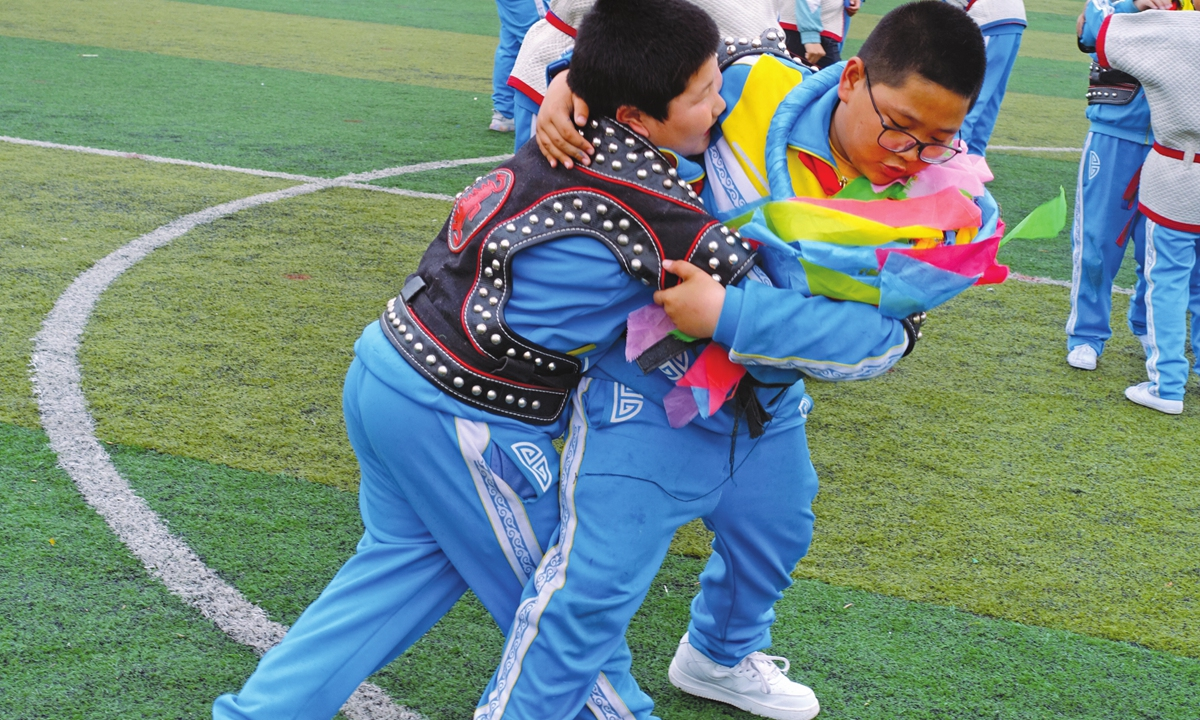 Daichin (right) competes with his classmate during awrestling class on Friday. Photo: Lin Xiaoyi/GT