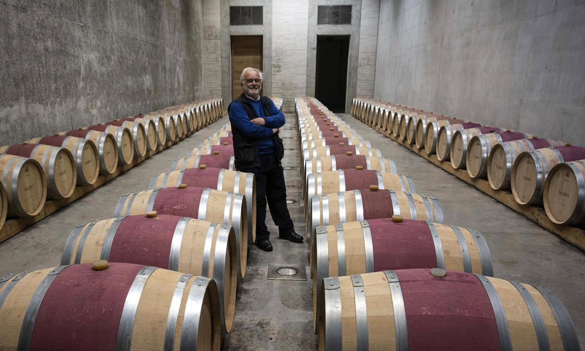 The owner of chateau Thuerry vineyard, Jean Louis Croquet poses inside his wine cellar in Villecroze, southern France, on May 7. Photo: AFP
