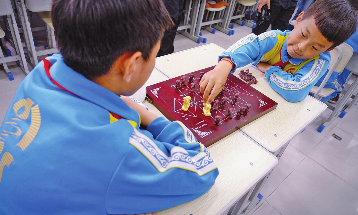 Students play traditional Mongolian deer chessat the activity center on Friday. Photo: Lin Xiaoyi/GT