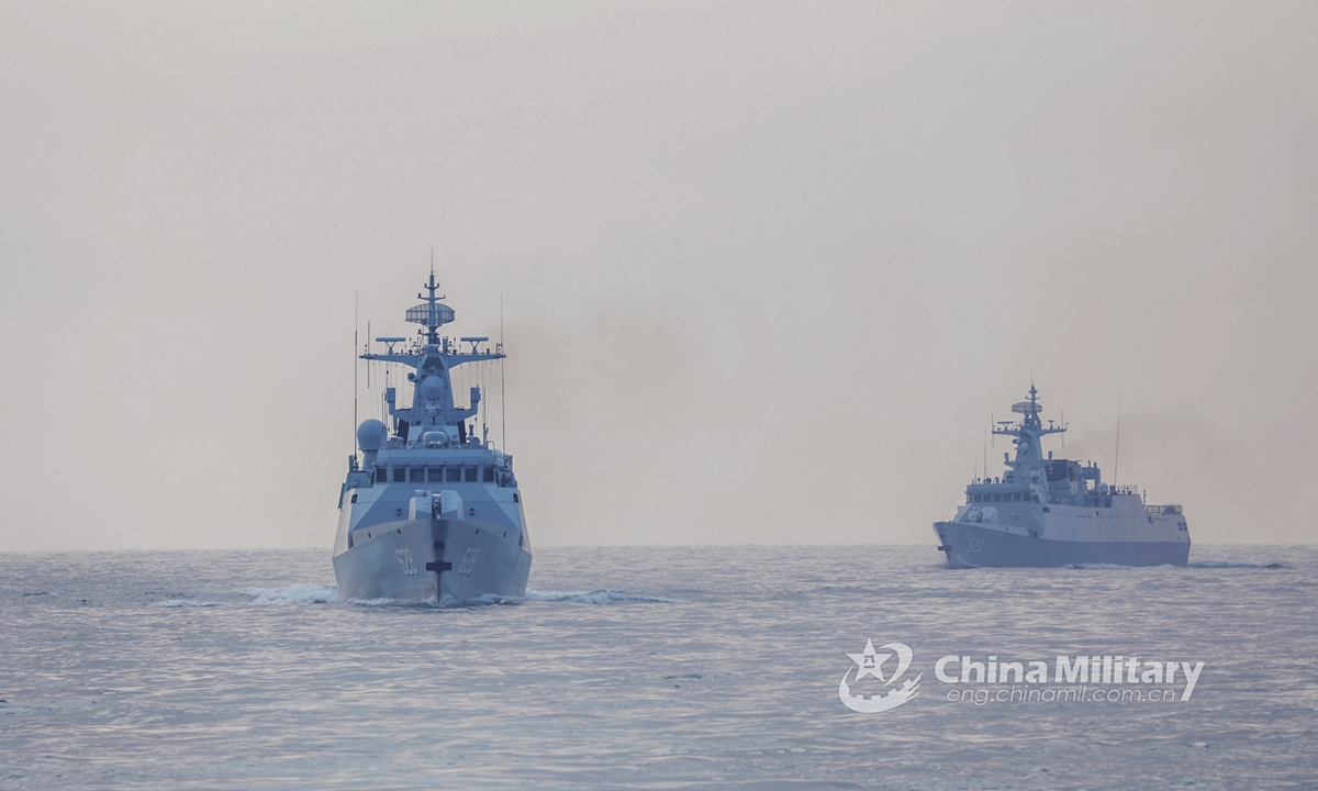 Two warships attached to a naval frigate flotilla under PLA's Southern Theater Command carry out coordination drill during a maritime combat training exercise on April 21, 2021. Photo: China Military Online