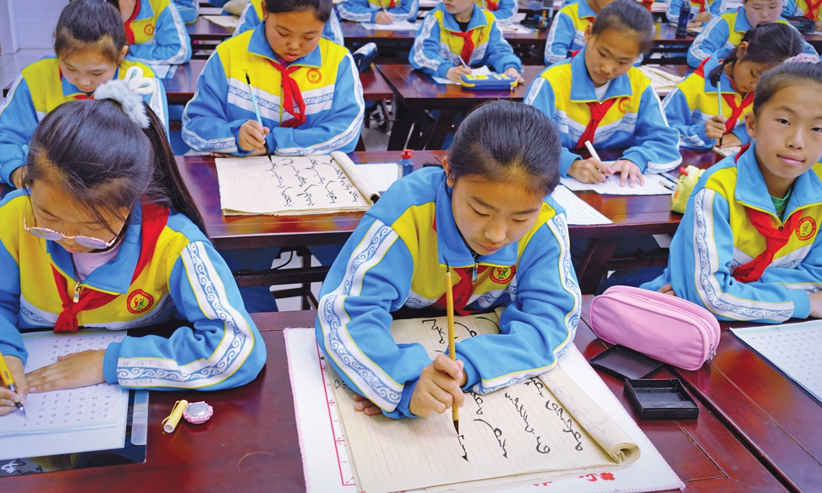 Students of No. 1 Primary School of Horqin Right Front Banner on Fridayattenda calligraphy class where they can freely choose to write in Chinese or Mongolian. Photo: Lin Xiaoyi/GT