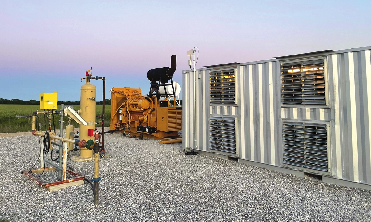 A natural gas generator powers a Bitcoin mining data center on an oil field in north Texas, the US, on May 6. Photo: AFP