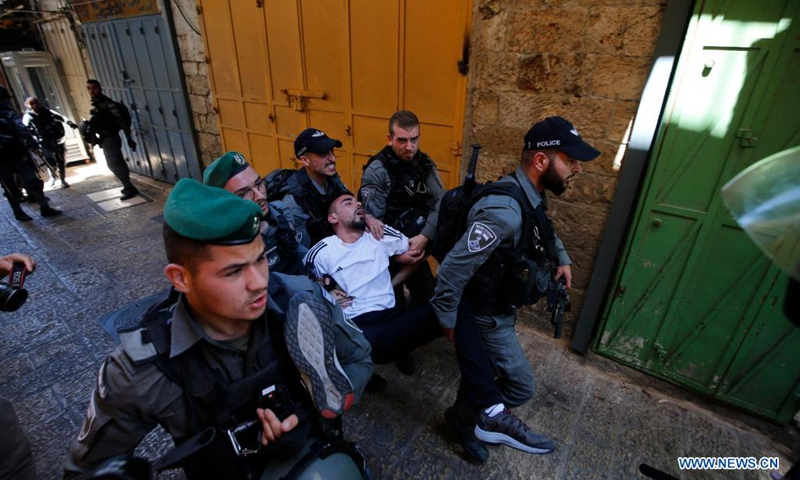 Israeli police arrest a Palestinian during a protest in Jerusalem's Old City, on May 18, 2021.(Photo:Xinhua)