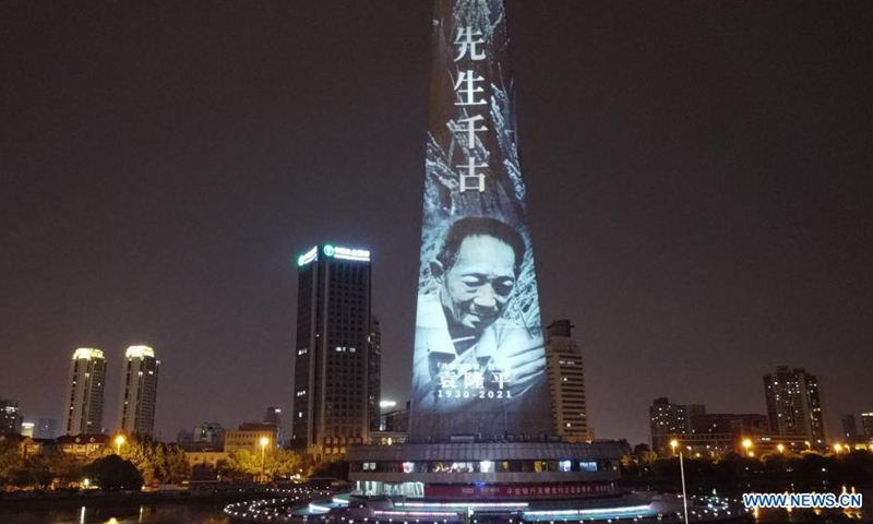 A landmark is lit up in remembrance of Yuan Longping in north China's Tianjin, May 22, 2021. Chinese scientist Yuan Longping, renowned for developing the first hybrid rice strain that relieved countless people of hunger, died of organ failure at 91 on Saturday.(Photo: Xinhua)