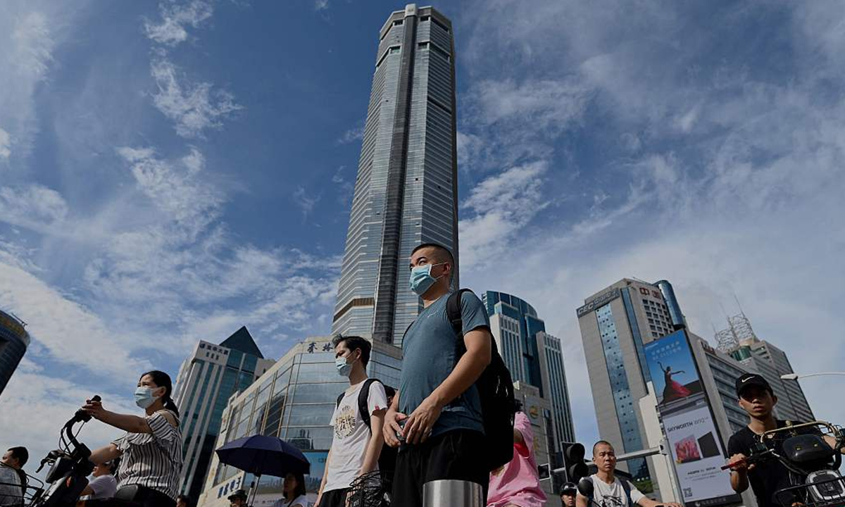 People walk past the temporarily closed 300-meter SEG Plaza in Shenzhen, South China's Guangdong Province on May 24, 2021. Photo: CFP