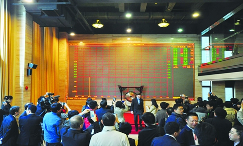 The opening ceremony for carbon trading at Shanghai Environment and Energy Exchange on Tuesday Photo: CFP