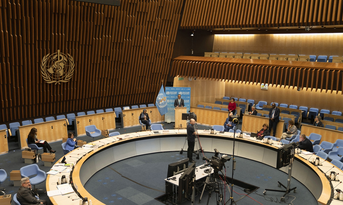 The World Health Organization assembly room with WHO Director-General Tedros Adhanom Ghebreyesus delivering a speech in May 2020 Photo: AFP