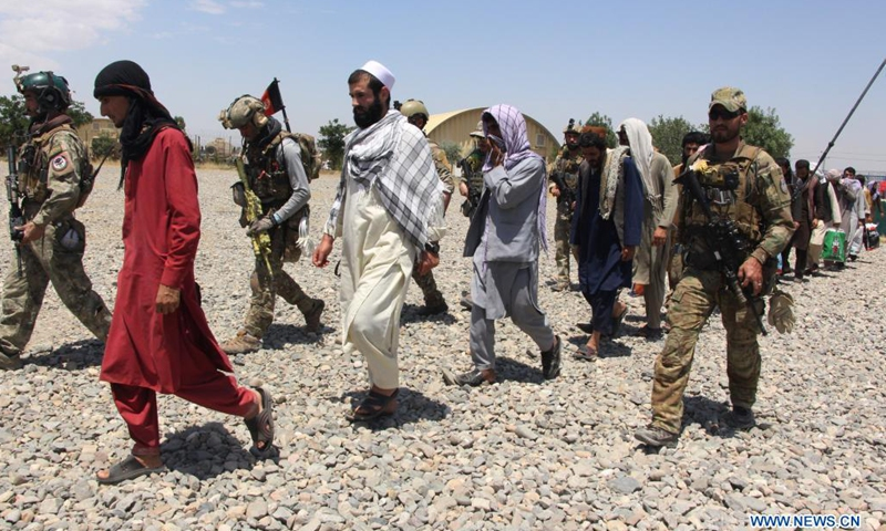 Photo taken in Kunduz city, Afghanistan on May 26, 2021 shows people who were rescued by Afghan Special Forces from a Taliban detention center located in neighboring Baghlan province. A total of 62 hostages including 36 security personnel have been set free after the Afghan Special Forces stormed a Taliban detention center in northern Baghlan province on Wednesday, an army statement said.(Photo: Xinhua)