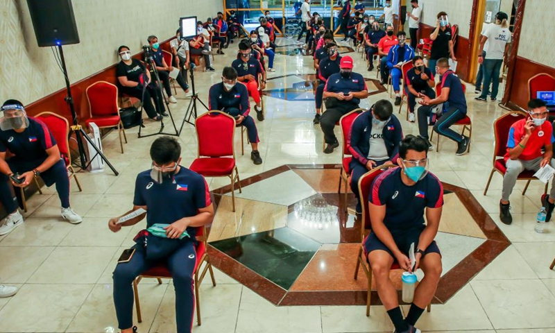 Athletes wait to receive COVID-19 vaccines in Manila, the Philippines on May 28, 2021. Around 700 athletes including dozens of athletes who are qualified for the Tokyo Olympics and are about to participate in the Olympic trials, as well as those who will participate in this year's Southeast Asian Games were vaccinated.Photo:Xinhua